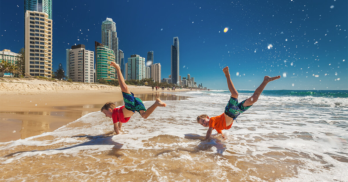 Kids having fun at Gold Coast beach | Austate Removals