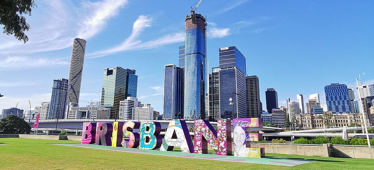 Brisbane letter sign in front of skyline
