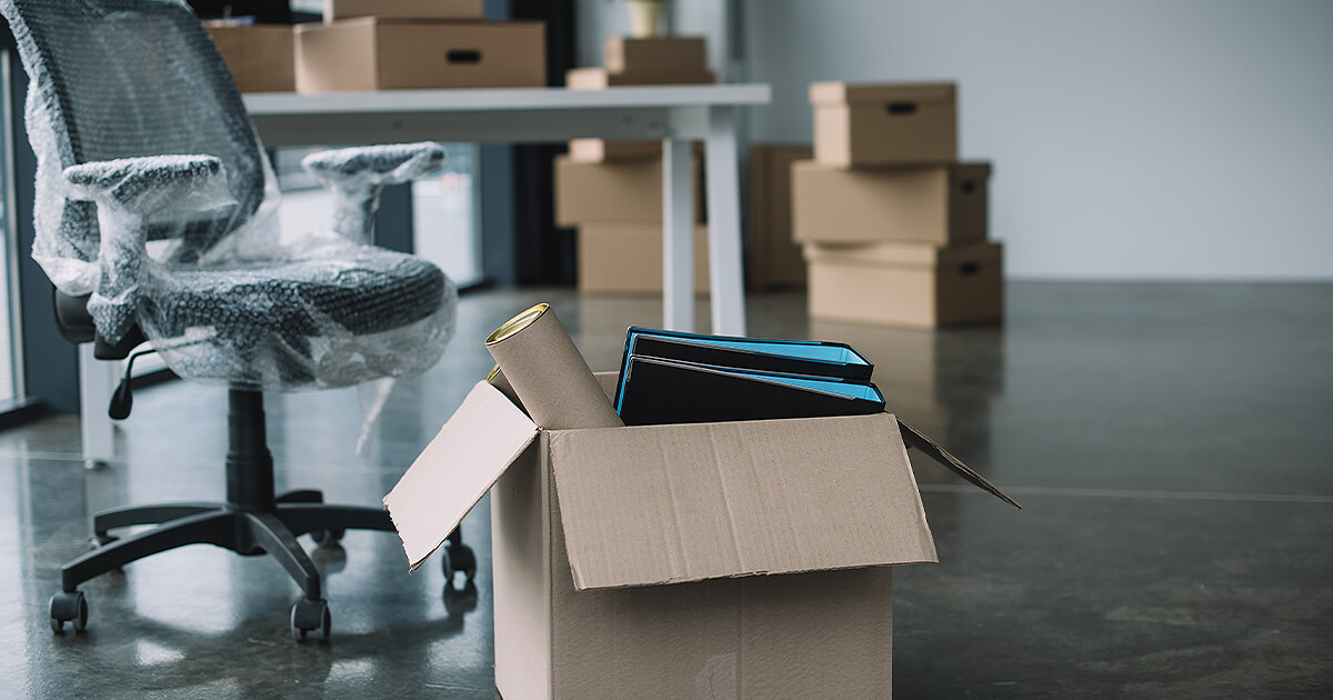 Business files in boxes with business chair in bubble wrap waiting for business relocation