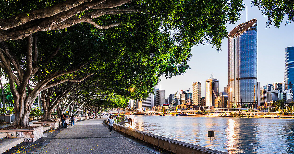 People walking and jogging on riverfront in Brisbane's South Bank