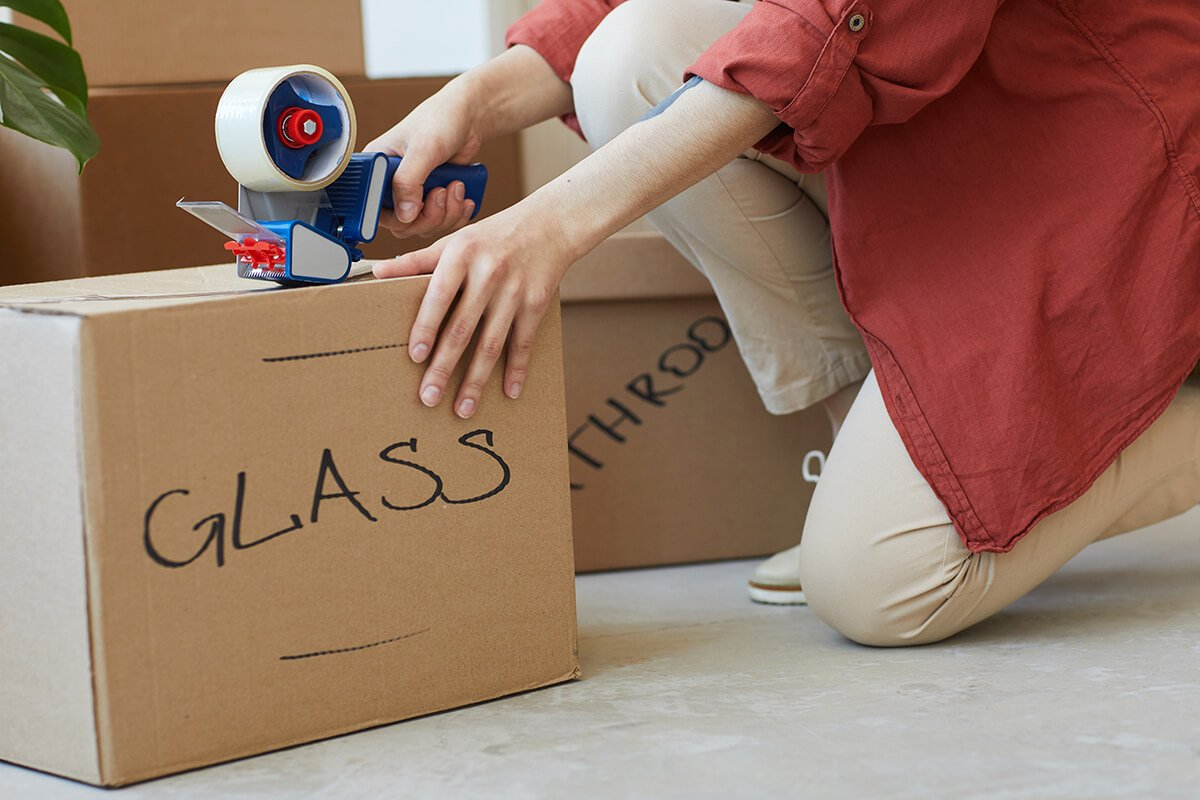 Woman packing box ready for local house move