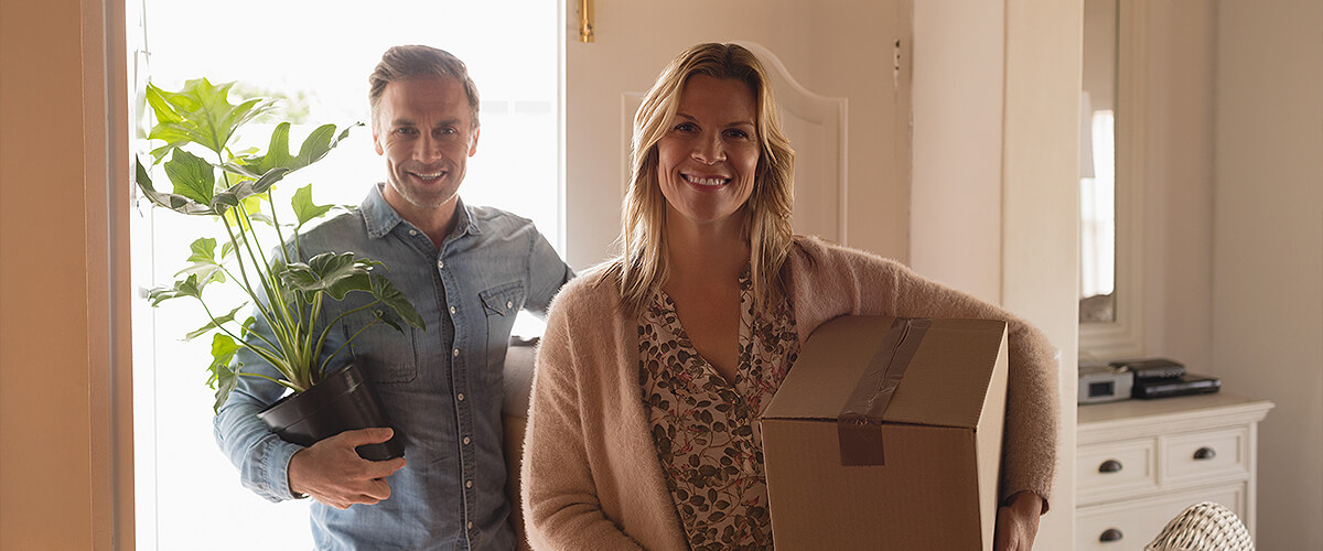 Couple moving last items out of home before they move house
