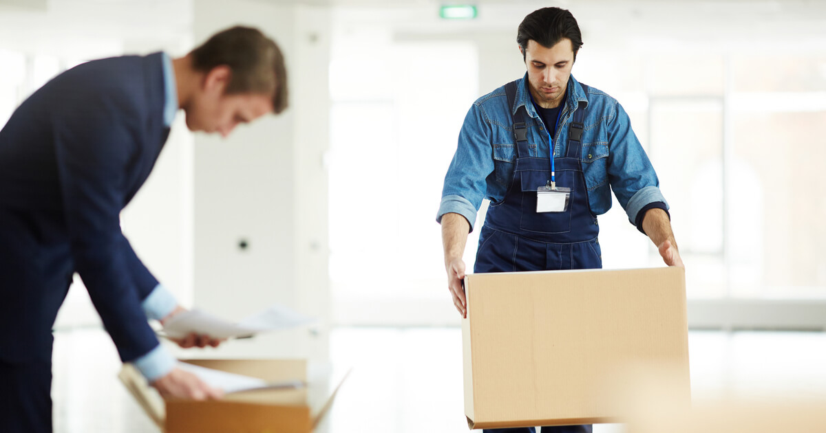 Businessman receiving help from a furniture removalist