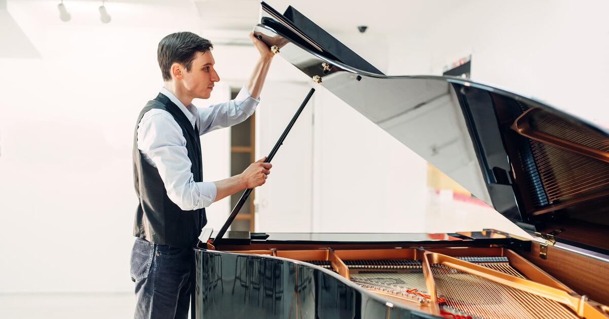 Man Lifting lid on piano